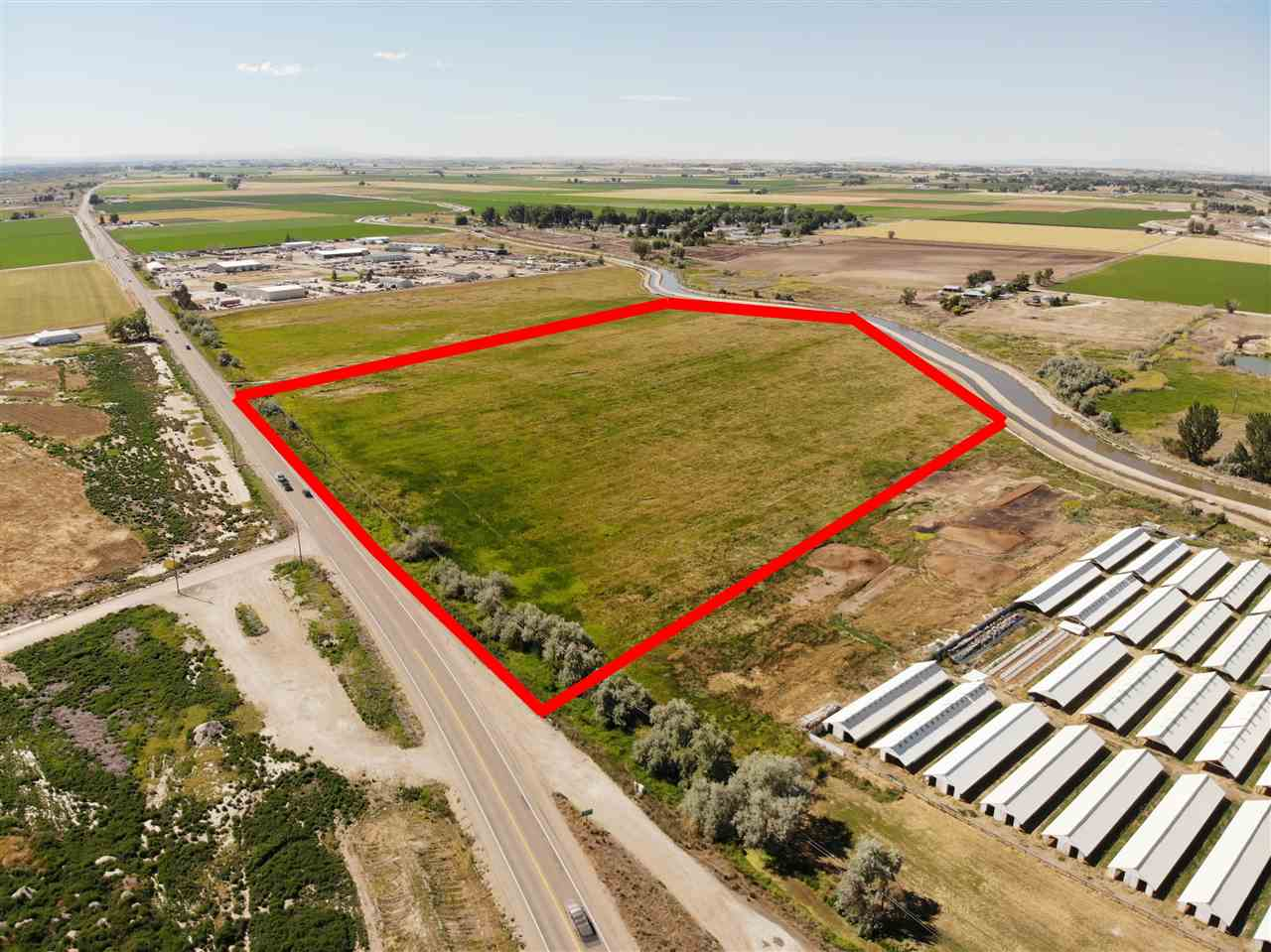 Fantastic opportunity for easy I-84 freeway access as well as Hwy 20-26 access. Located in the City Impact area with possible Commercial & Light Industrial rezone. Approx a total of 91.18+/- acres in this immediate area available to create larger or even smaller parcels for your needs. Currently zoned Ag w (62) 110' x 20' sheds and 1 home (sold as-is). City sewer and water in the immediate area. Call for details!