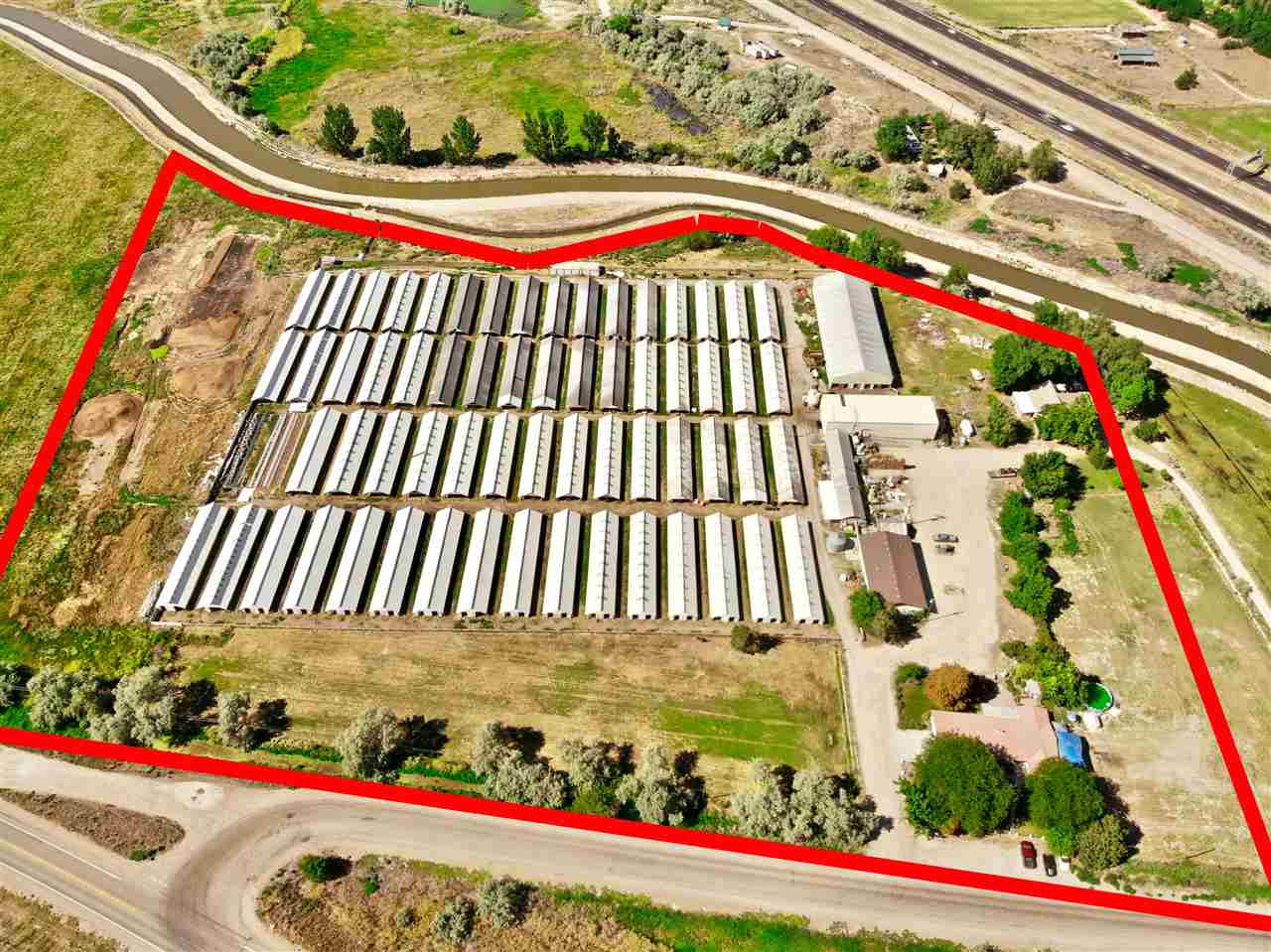 Fantastic opportunity for easy I-84 freeway access as well as Hwy 20-26 access. Located in the City Impact area with possible Commercial or Light Industrial rezone. Approx 91.18+/- acres in this immediate area available to create larger or even possibly smaller parcels for your needs. Currently zoned Ag w/ (62) 110' x 20' Sheds and 1 home (sold as-is). City sewer and water in the immediate area. Call for details.