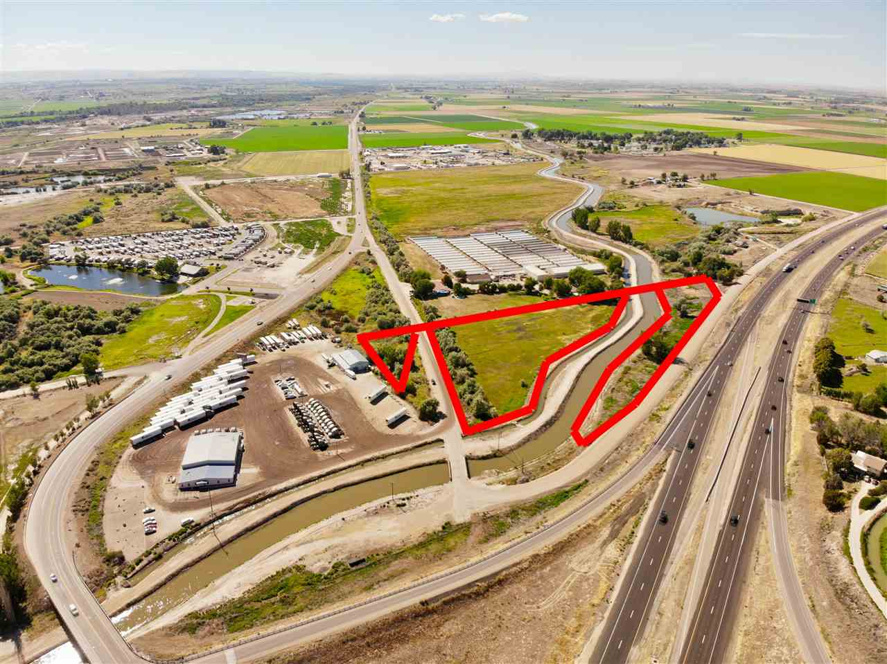 Fantastic opportunity for I-84 freeway frontage as well as Hwy 20-26 access. Located in the City Impact area with possible Commercial or Light Industrial rezone. Approx a total of 91.18+/- acres in this immediate area available to create larger or even possibly smaller parcels for your needs. Currently zoned Ag w/ 1 home (sold as-is). City sewer and water in the immediate area. Call for details.