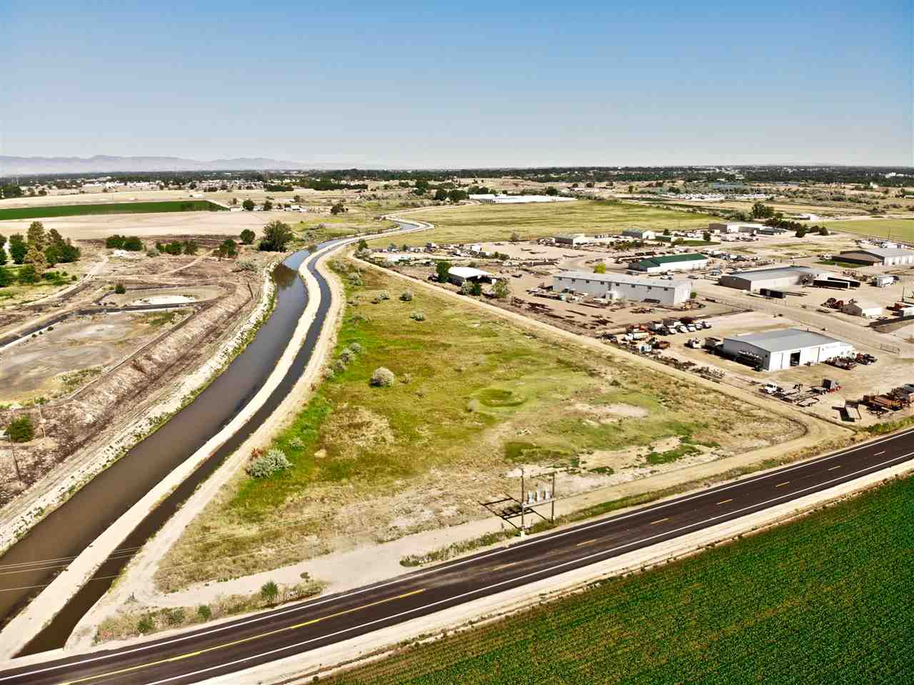 Fantastic opportunity for easy I-84 freeway and Hwy 20-26 access. Located in the City Impact area with possible Commercial or Light Industrial rezone. Approx a total of 91.18+/- acres in this immediate area available to create larger or even possibly smaller parcels for your needs. Currently zoned Ag. City sewer is located in the street and city water is across Hwy 20-26. Call for details.