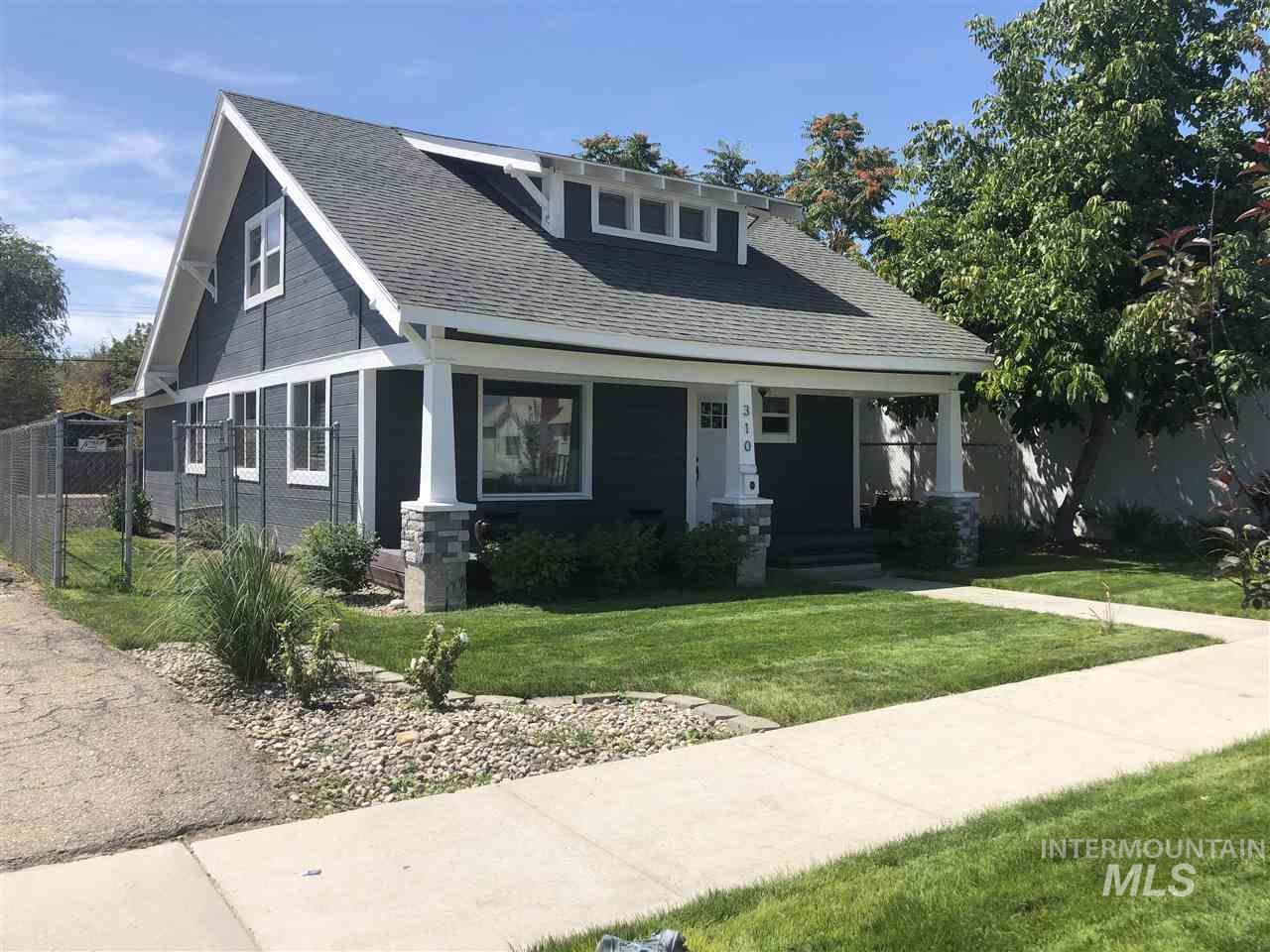 Beautiful, totally renovated, craftsman style home on a main thoroughfare through downtown Caldwell. Zoned commercial but grandfathered in as residential, this home is located in the