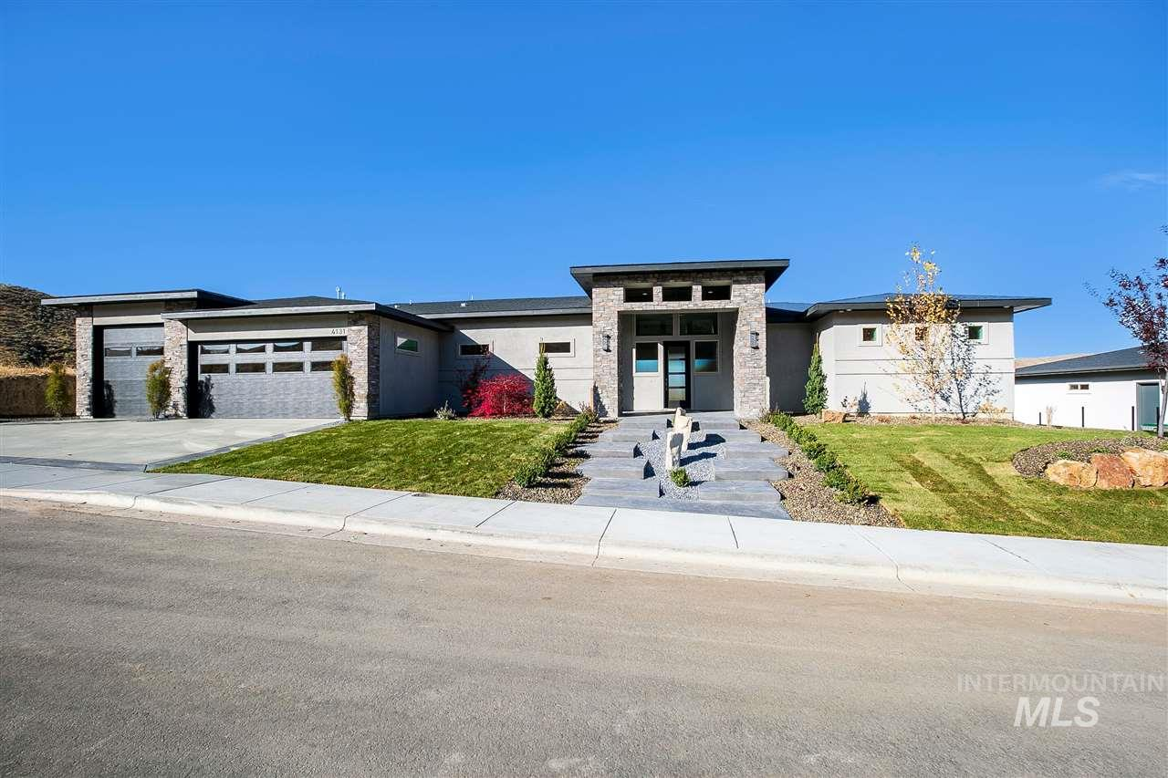 NEW PRICE! GOING FAST! BRAND NEW HOME & VIEWS! CLOSE TO DOWNTOWN BOISE! 3700 sf of the best! 4 bd, bonus rm, 3.5 bath, huge 3 car garage. Main level has 3 bed, 2.5 baths and VIEWS! Entertain guests in your gourmet kitchen, step out on your deck and soak up the breathtaking sunsets and views! Home is loaded with features-SUB-ZERO, WOLF, COVE, Custom fireplace, cabinetry, floating shelves, Covered patio & deck, coffered ceilings ambient lighting & much more! Enjoy golfing, Hiking in foothills Call PJ SMITH
